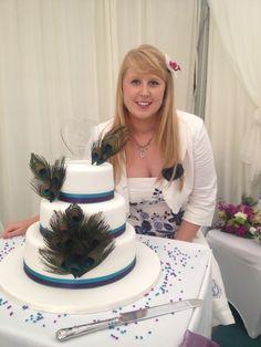 Peacock feathers wedding cake  simple white beautiful. Proud cake designer www.sarahlouisecakedesign.co.uk