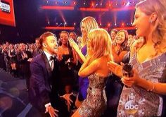 JT and Taylor did a fangirl thing after he won his first award... I haven't decided if this was cute or just plain weird???