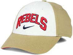Celebrate a long tradition of greatness in this Nike NCAA L91 Verbiage Swoosh cap. This cap features the Mississippi Rebels name in raised letters, and the single word is arched around a classic Nike swoosh. Mid crown Structured fit Normal bill Raised embroidered team wordmark at front Raised embroidered Nike swoosh logo at front Flat embroidered team logo at back Stretch fitted Cotton/spandex Spot clean only