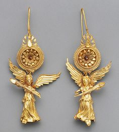 Earrings, 225-175 BC, Greek, Gold And Glass - The Figures Of Nike, Greek Goddess Of Victory, Form The Main Decoration Of These Gold Earrings, Each Of The Tiny Figures Is Hollow, Made From Two Joined Sheets Of Gold That Were Formed In A Mold - Getty Villa Malibu