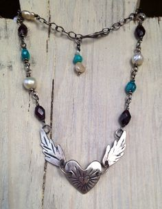 Winged heart in sterling silver with pearls, turquoise and garnet chain, by Julianne Van Buskirk.