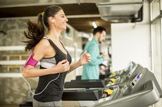 Young woman running on the treadmill and listening to music at the gym  Treadmill Workouts 9c668a5fccd1