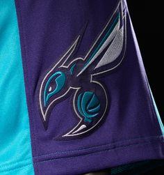 SHORTS · Secondary logo on purple background on bottom left leg