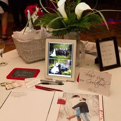 At the reception, Rachel and Tyler displayed an iPad which scrolled through pictures of the couple, a guestbook for guests to sign, and a small sign telling guests to sit wherever they wanted to. Photo Credit: Amenson Studio