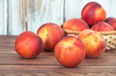 Closeup of peach fruits on a wooden table
