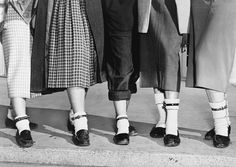 Teenage girls wearing dog collars fastened around their ankles, on the right if they had a boyfriend and on the left if they were single, 1953.