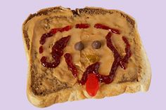 How Much is that Doggy in the Sandwich?: Peanut Butter Workshop Sandwich #492: Marble bread with Old Fashioned Smooth peanut butter, a jam face, and a candy tongue.