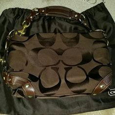 Authentic coach purse Authentic brown coach bag, leather strap, some light discoloration on one side ( pictured where fingers are) other then that great condition used sparingly. Coach Bags Shoulder Bags