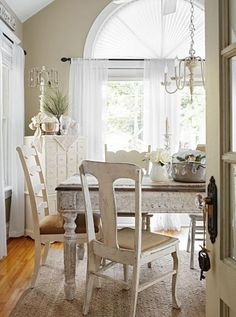 A mix of chairs looks casual around an old farm table. Vintage—and white—items are the heart of the French farmhouse decorating style in this 1909 Illinois home. More dining rooms: http://www.midwestliving.com/homes/room-decorating/dining-room-decorating-styles/?page=4