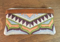 This little purse is the perfect accessory for a night out on the town. It is sophisticated with lush silk needlepoint embroidery paired with the soft deer hide leather. But it has a fun trendy style that makes it a great statement accessory to go with your awesome party outfit. The needlepoint embroidery is a unique pattern I designed inspired by the beautiful geometric patterns used in kilim rugs and the organic shapes of lotus blossoms. The silk colors are peach periwinkle ivory eggplant…