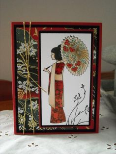 handmade card: lady in red by rokale  ... colors used to match the beautiful Japanese print on the background paper ...   geisha with parasol ....