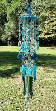 SOLD. This divine crystal wind chime captures the seductive colors of billowy ocean waves that we find so mesmerizing...Antique ornate brass top
