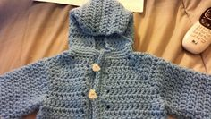 Crochet hooded sweater for a baby boy. Found this on you tube.