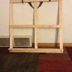 So my daughters cheap toddler bed fell apart but some of the wood was salvageable. I decided to try and make one of those old window ideas to hang picture frames in and this is what I came up with (granted it's not finished as I am going to spray paint it and scratch it up to make it look vintage. It's my first attempt at carpentry without instructions so yes some of it is crooked but is completely fixable when I hang it with just ribbon on a large nail!!!