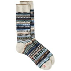 The CHUP sock range is made by Japanese textile professionals Glen Clyde. Expertly crafted using the finest materials, this hugely popular collection features bright patterns inspired by native cultures from across the globe. Made from a fine cotton-blend yarn, the Missouri Sock features a design based on the costumes and feather decorations traditionally worn by Native American tribes for sun dances. Cotton-Blend Yarn Fair Isle Design Made In Japan
