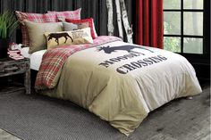 """The familiar pattern of wildlife is completely re-imagined in Lamington's reversible moose and plaid design. Expertly coordinate it with our lodge collection cushions and envisage yourself in a cabin nestled in a pine forest with fabulous views of glacier summits!100% Cotton, reverses to 100% cotton flannelPrintShown with Aspen, Lodge Jute Moose 12x25"""" and Rowan Red 18x18 cushions"""