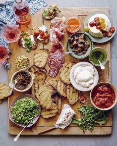 easy party hosting tips: set out a no-cook appetizer bar, like this bruschetta bar from What's Gaby Cooking? Delicious.