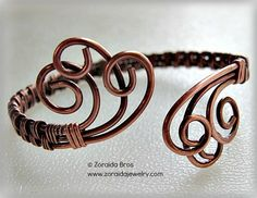 """This beautifully graceful copper bracelet is adjustable.  It will fit wrist sizes from small  (6 inches) to medium  (7 1/2"""") best.   Three heavy gauge wires have been woven in a basket weave pattern a"""