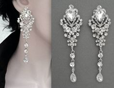Chandelier statement earrings ~ Long crystal earrings ~ Brides earrings ~ Crystal wedding earrings ~ Crystal chandelier earrings ~ These long, silver, chandelier, crystal rhinestone, statement earrings are just exquisite! Perfect bridal jewelry. Brides, pageant, Prom or any other special occasion. They have a Victorian style to them. They are ready for your formal affair.  These beauties are filled with shining crystal rhinestones and cubic zirconia teardrops. The total lenght of these is 3…