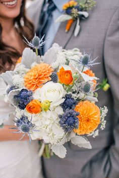 Love white, blue and orange wedding bouquet