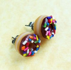 chocolate glazed doughnut stud earrings..funny if a female cop wore these to play on the stereotype!