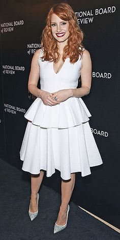 "JESSICA CHASTAIN Jessica pairs her Alexander McQueen dress and embellished Christian Louboutin pumps with rich red lipstick for the 2014 National Board Review Gala in N.Y.C. If the ""white dress and deep red lip combination"" seems familiar, it's because the star wore a similar look to the Governors Awards."