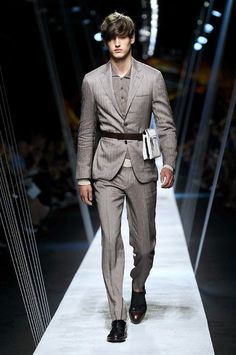 We are big fans of Canali and are always happy to take a look at their latest creations. From their spring-summer 2017 collection, which featured many sharp tailored suits and separates, which is one of the main Canali staples, this belted outfit was our favorite. If you ever wondered how to wear a belt over a suit jacket, here's how you can do it! Loved the tightness and the attached accessory!