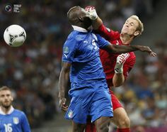 Italy's Balotelli collides with England's Hart during their Euro 2012 quarter-final soccer match against England at the Olympic stadium in Kiev. TONY GENTILE/REUTERS