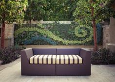 This picture was to feature the couch - but forget that!  I LOVE this back planted vertical garden!!