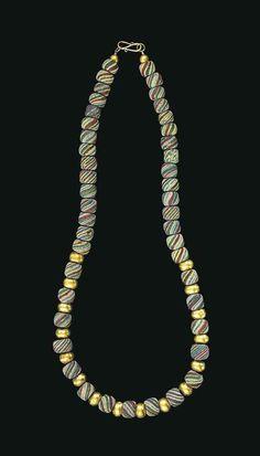 A ROMAN GLASS BEAD NECKLACE