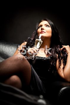 young woman enjoying a glass of champagne Glass Of Champagne, Video Image, Magazine Articles, Feature Film, Photo Illustration, Young Women, Royalty Free Images, Wonder Woman, Stock Photos