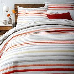 Just bought both colors of this Duvet. The Coral/Grey for the warmer, sunny months and the cool tone blues for the cooler winter months! A bold choice for the mainly grey bedroom. Plus the price means I can afford 2 for the price of one!   Watercolor Stripe Duvet Cover + Shams #westelm