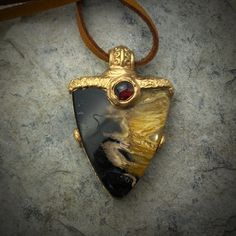 PETRIFIED FOSSIL WOOD Pendant, w/Garnet, 24K gold plated, Handmade, BoHo-Style, Fossil Wood Necklace, approx. 20 Mil y old / Indonesia by GingerandFoxy on Etsy Wood Necklace, Leather Necklace, Dendritic Agate, Spiritual Jewelry, Deer Skin, Coachella, Boho Style, Ibiza, Fossil