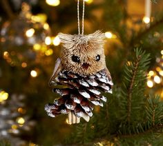 Pottery Barn pinecone critter ornament collection includes a penguin, reindeer, owl and squirrel