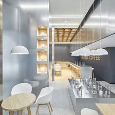 Andreas Petropoulos has recently completed the design of Daily Dose, a small takeaway coffee bar in the city of Kalamata, Greece, that features a white, black and wood interior. from contemporist