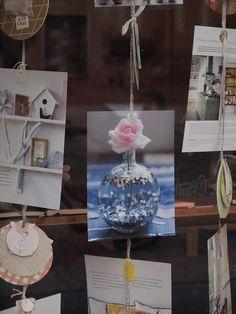 "love the window display, especially the vase ""snow"" globe photo"