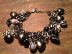 Badass gunmetal rocker chick charm bracelet with black skulls, purple agate, hearts and crystals by gypsypalace7, $42.00 on Etsy https://www.etsy.com/listing/164087079/bad-ass-gunmetal-rocker-chick-charm