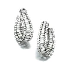 PAIR OF DIAMOND EAR CLIPS, HARRY WINSTON. Each of hoop design, set with brilliant-cut and baguette diamonds, mounted in platinum, unsigned, maker's marks for Jacques Timey.