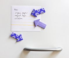 these would be so cute in a scrapbook!!  Minus the magnet...  How to make origami arrow magnets