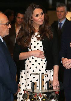 Pregnant Mamas can't help but touch their bellies! We love this photo of Kate Middleton!