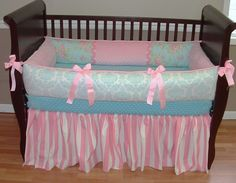 Shabby Chic Baby Bedding  Included in this custom baby bedding set is the bumper, blanket(not pictured but included), and crib skirt.  There are lots of details in this shabby chic crib set including soft pink minky, pink grosgrain ties, designer cotton prints in aqua blue damask, floral, and pink and white polka dot and stripe.