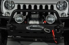 2014 Jeep Wrangler Unlimited in Porsche GT Silver Kevlar Exterior: Custom Lights and Winch
