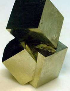 Intersecting cubes of Iron Pyrite. Iron Pyrite, is an iron sulfide with the formula FeS2.