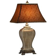 """$95 32"""" Height The ageless style of this ginger jar resin table lamp is evident in its carved footed platform base, antique gold tone finish, and patterned square bell softback shade. This lovely lamp will truly add a touch of style to any room in your home."""