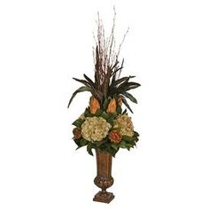 "Preserved hydrangea and protea arrangement in a weathered fluted planter.   Product: Preserved floral arrangementConstruction Material: Preserved floralsColor: MultiFeatures: Includes hydrangeas and proteasDimensions: 28"" H x 8"" Diameter"