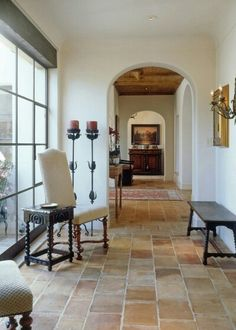 Southwest style white cement/adobe walls and tile floor.