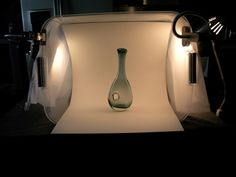 diy lightbox out of a plastic bin, poster board and lights.