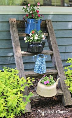 Calling all tea lovers: This series of smaller tea pot container gardens on a rustic ladder gives a nod to your favorite beverage.