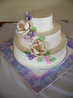 Simple design with Sugar flower cascade (large champagne peonies, purple orchids and pink hydrangeas) Horizontal textured buttercream