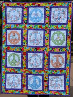 Cross Stitched Peace Sign Baby Quilt by InnovativeCreate on Etsy